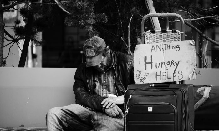 A homeless man in Seattle, Wash. To really help homeless people, we need to understand the reasons why people become homeless in the first place. (Steve Knutson/Unsplash)