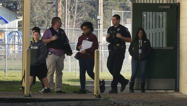 Police officers escort children
