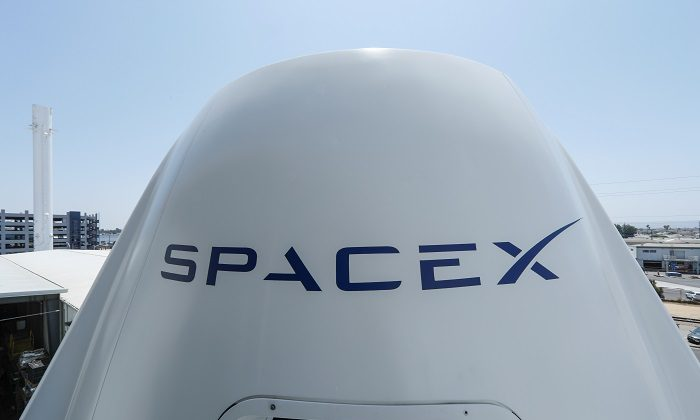 The top of a replica Crew Dragon spacecraft is show at SpaceX headquarters in Hawthorne, Calif., on Aug. 13, 2018. (Mike Blake/Reuters)