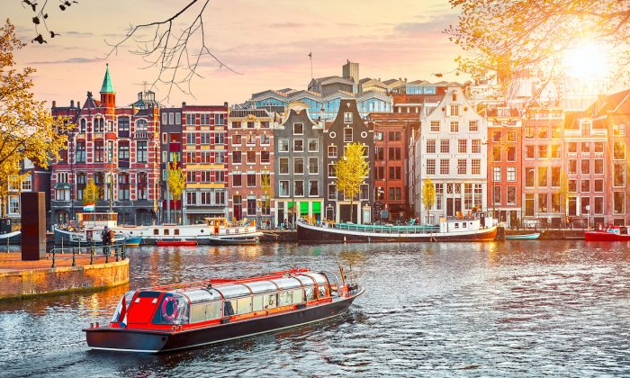 Colorful buildings line Amstel River in Amsterdam. (Shutterstock)