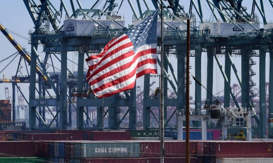 The U.S. flag flies over Chinese shipping containers that were unloaded at the Port of Long Beach, in Los Angeles County, on Sept. 29, 2018. (Mark Ralston/AFP/Getty Images)