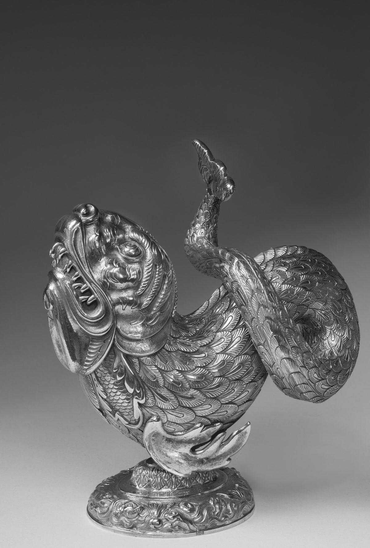 Dolphin german in silver sculpture