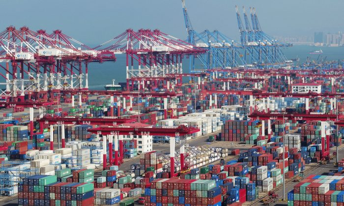Containers and trucks are seen at a terminal of the Qingdao port in Shandong Province, China on Nov. 8, 2018. (Reuters)