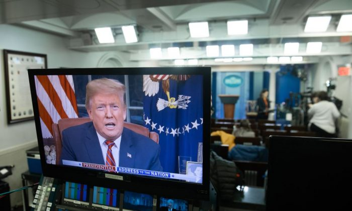 President Donald Trump appears on a television screen in the Press Briefing Room of the White House in Washington on Jan. 8, 2019, as he speaks during a presidential address about the government shutdown and border security from the Oval Office. (Saul Loeb/AFP/Getty Images)