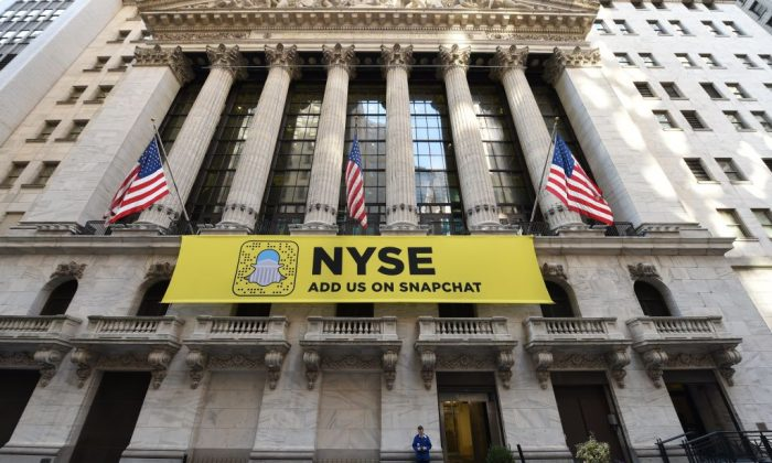 A trader stands in front of New York Stock Exchange on Wall Street in New York January 25 , 2017. (TIMOTHY A. CLARY/AFP/Getty Images)
