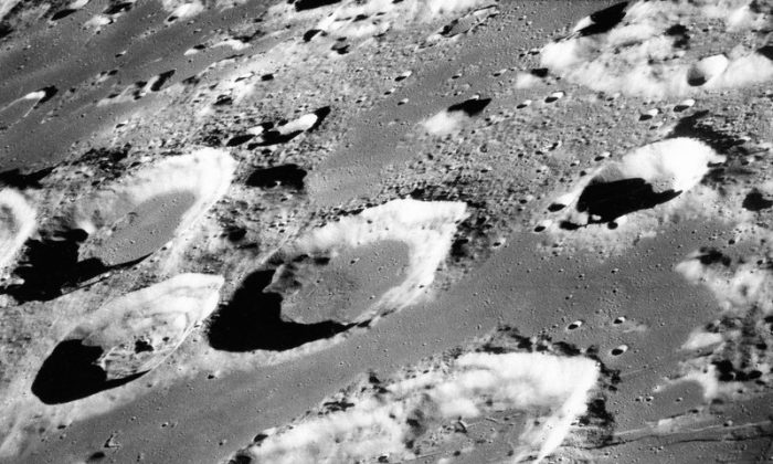 This Dec. 29, 1968 photo made available by NASA shows the large moon crater Goclenius, foreground, approximately 40 statute miles in diameter, and three clustered craters Magelhaens, Magelhaens A, and Colombo A, during the Apollo 8 mission.(NASA via AP)