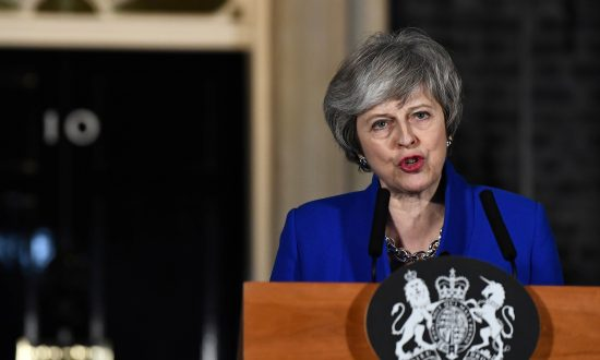 Britain's Prime Minister Theresa May makes a statement following winning a confidence vote, after Parliament rejected her Brexit deal, outside 10 Downing Street in London, Britain, on Jan. 16, 2019. (Clodagh Kilcoyne/Reuters)