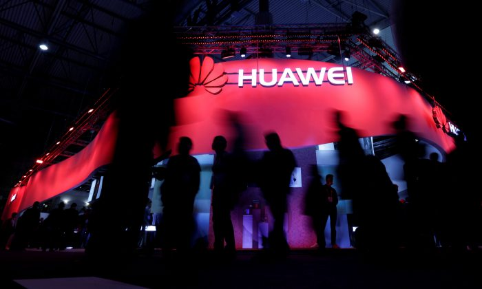 Visitors walk past Huawei's booth during Mobile World Congress in Barcelona, Spain on Feb. 27, 2017.  (Eric Gaillard/Reuters)