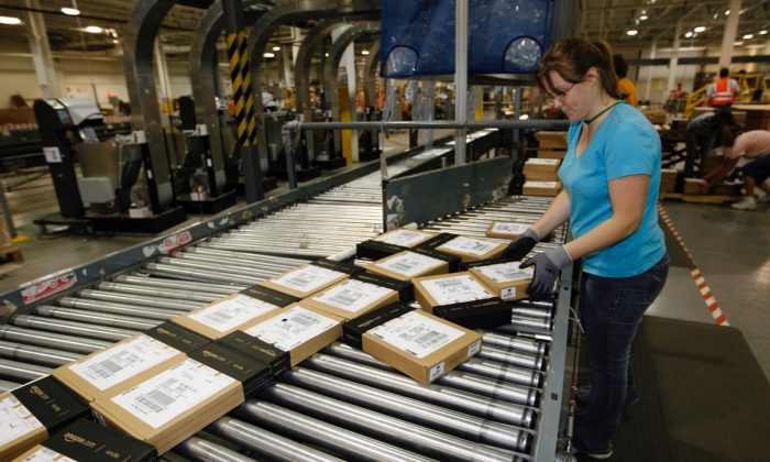 Amazon employee Heather Redman works to pack products for shipment at an Amazon warehouse in Campbellsville, Kentucky on June 10, 2009. (John Sommers II/Getty Images)