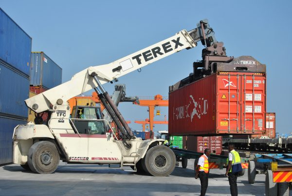 a crane is picking up cargo
