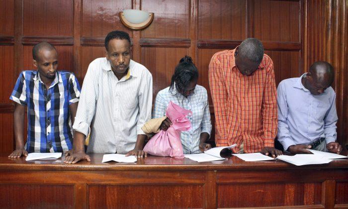 (L-R) suspects Osman Ibrahim, Canadian Guleid Abdihakim, Gladys Kaari Justus, Oliver Kanyango Muthee, and Joel Nganga Wainaina appear at a hearing at Milimani law courts in Nairobi, Kenya, on Jan. 18, 2019. (AP Photo)