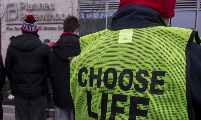 Demonstrators gather during a protest vigil sponsored by The Christian Defense Coalition and Priests for Life outside Planned Parenthood of Metropolitan Washington, Carol Whitehill Moses Center on Jan. 17, 2019, in Washington. (Zach Gibson/Getty Images)