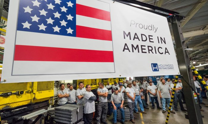 Workers at the Hollywood Bed Frame Company attend an event to mark the company's upcoming expansion which will double the manufacturer's workforce, adding 100 new local jobs, at the company's factory in Commerce, Calif., seven miles southeast from downtown Los Angeles on April 14, 2017. (Robyn Beck/AFP/Getty Images)