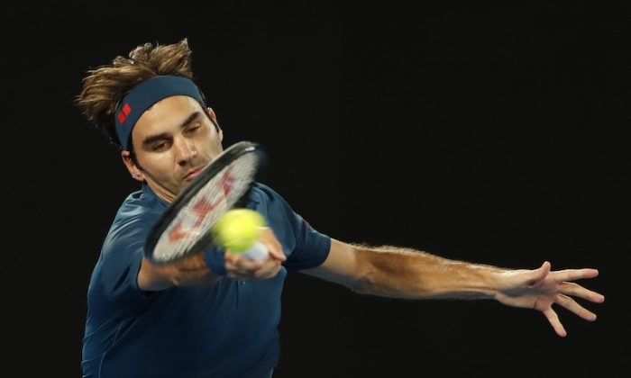 Switzerland's Roger Federer in action during the match against Greece's Stefanos Tsitsipas at the Australian Open in Melbourne, on Jan. 20, 2019. (Reuters/Adnan Abidi)