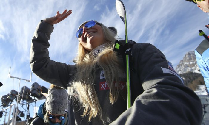 United States' Lindsey Vonn waves as she stands in the finish area after completing an alpine ski, women's World Cup super-G in Cortina D'Ampezzo, Italy, on Jan. 20, 2019. (Alessandro Trovati/AP)
