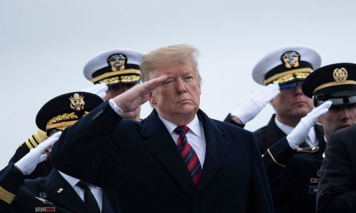 President Donald Trump and others pay their respects as the remains of Scott A. Wirtz, a Defense Intelligence Agency civilian and former Navy Seal, are carried by during a dignified transfer for U.S. personal killed in a suicide bombing in Syria at Dover Air Force Base in Dover, Delaware, on Jan. 19, 2019. (Brendan Smialowski/AFP/Getty Images)
