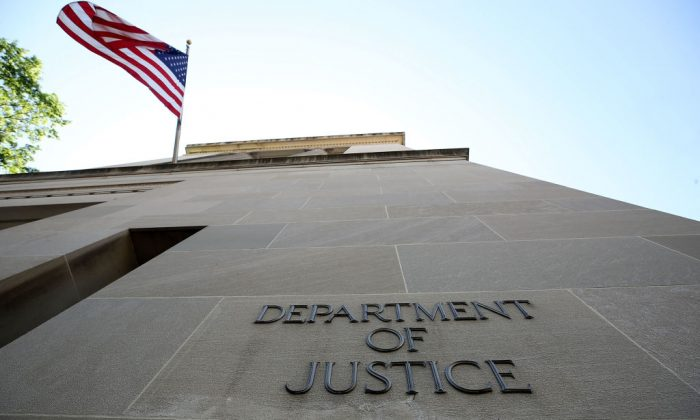 An American flag flies outside of the Justice Department, in Washington, DC, on May 24, 2018. (Mark Wilson/Getty Images)
