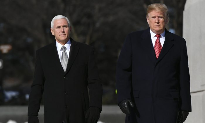 U.S. President Donald Trump (R) and Vice President Mike Pence visit the Martin Luther King Jr. Memorial in Washington on Jan. 21, 2019. (Mandel Ngan/AFP/Getty Images)