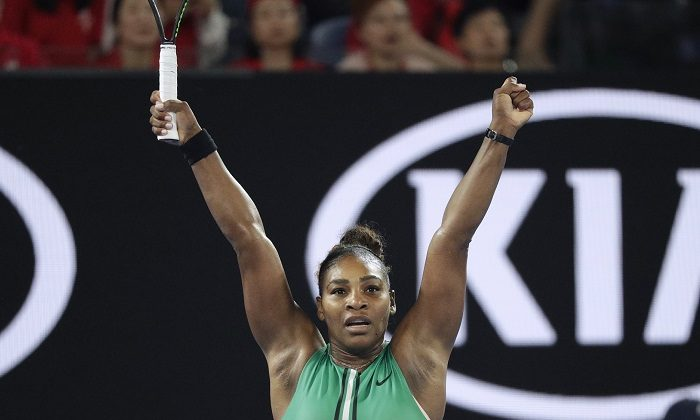 United States' Serena Williams celebrates after defeating Romania's Simona Halep in their fourth round match at the Australian Open tennis championships in Melbourne, Australia, on Jan. 21, 2019. (Kin Cheung/AP Photo)