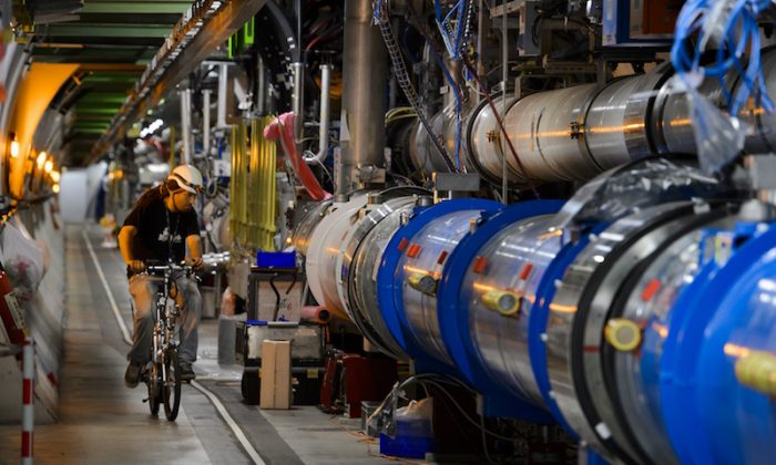 A worker rides on his bicycle in the CERN's Large Hadron Collider (LHC) tunnel during maintenance works in Meyrin, near Geneva on July 19, 2013.  (Fabrice Coffrini/AFP/Getty Images)