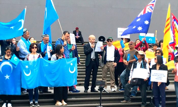 Omer Kanat, from the World Uyghur Congress, speaks at a Human Rights Walk rally in Melbourne, Australia on Dec. 9, 2018. (Rita Li/Epoch Times)