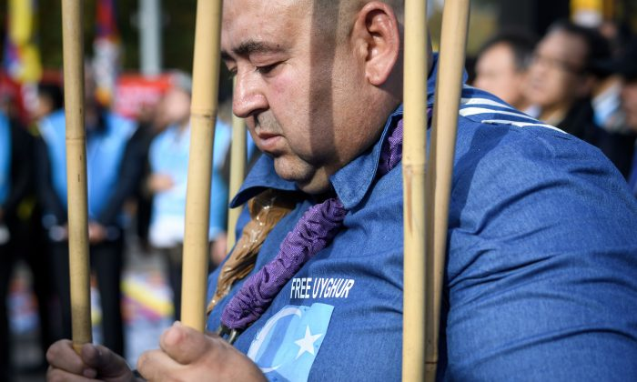 Uyghurs demonstrate against China outside of the United Nations (UN) offices during the Universal Periodic Review of China by the UN Human Rights Council in Geneva on Nov. 6, 2018 (FABRICE COFFRINI/AFP/Getty Images)