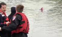 Viral Video Shows Daring Cop Jumping Into Flatrock River to Save a Woman