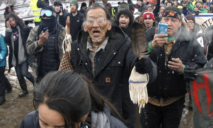 Nathan Phillips, center with glasses, and other Dakota Access Pipeline protesters march in North Dakota, on Feb. 22, 2017. (Mike McCleary/The Bismarck Tribune via AP, File)