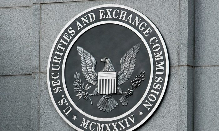 The U.S. Securities and Exchange Commission seal hangs on the facade of its building in Washington on Sept. 18, 2008. (Chip Somodevilla/Getty Images)