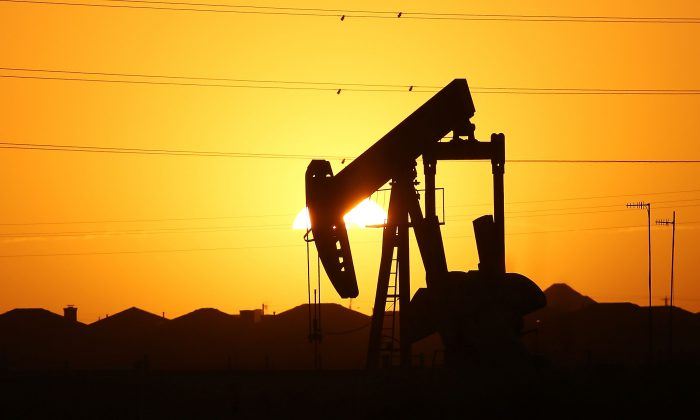A pumpjack on the outskirts of town at dawn in the Permian Basin oil field on Jan. 21, 2016, in the oil town of Midland, Texas.(Spencer Platt/Getty Images)