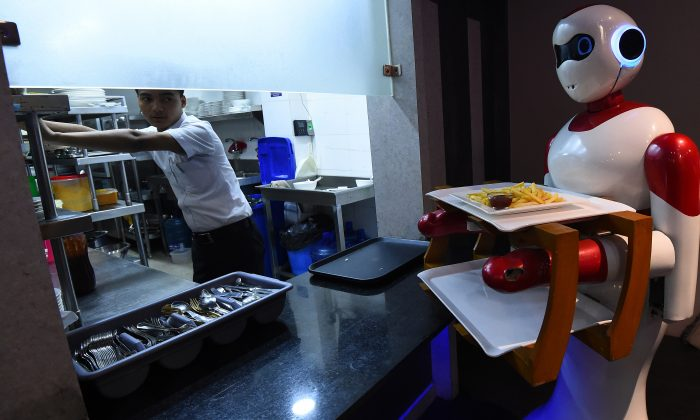 A Nepali-made robot waiter picks up food from the kitchen to bring to customers at Naulo restaurant in Kathmandu, on Oct. 26, 2018. (Prakash Mathema/AFP/Getty Images)