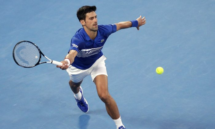 Serbia's Novak Djokovic makes a forehand return to France's Lucas Pouille during their semifinal at the Australian Open tennis championships in Melbourne, Australia, on, Jan. 25, 2019. (Kin Cheung/AP Photo)