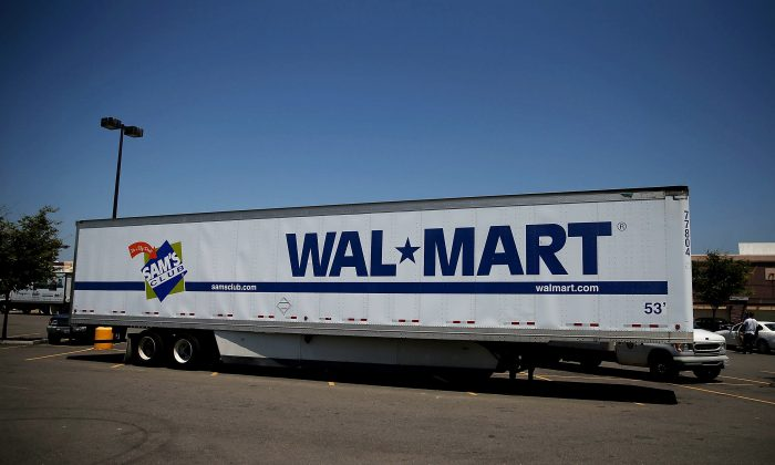 A Wal-Mart truck trailer sits in the parking lot of a Wal-Mart store in San Leandro, Calif., on June 11, 2015. (Justin Sullivan/Getty Images)
