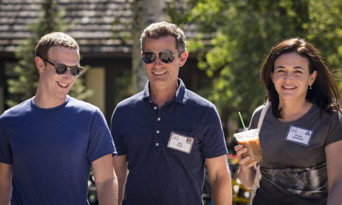 Mark Zuckerberg, CEO of Facebook, Dan Rose, VP, partnerships at Facebook, and Sheryl Sandberg, COO of Facebook, attend the annual Allen & Company Sun Valley Conference in Sun Valley, Idaho on July 12, 2018. (Drew Angerer/Getty Images)