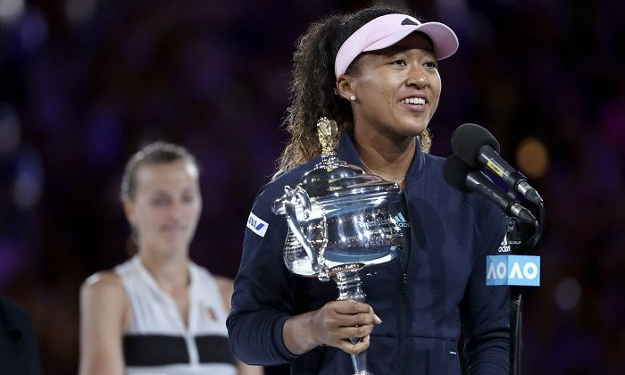 Japan's Naomi Osaka holds her trophy after defeating Petra Kvitova, left, of the Czech Republic during the women's singles final at the Australian Open tennis championships in Melbourne, Australia, on Jan. 26, 2019. (Mark Schiefelbein/AP Photo)