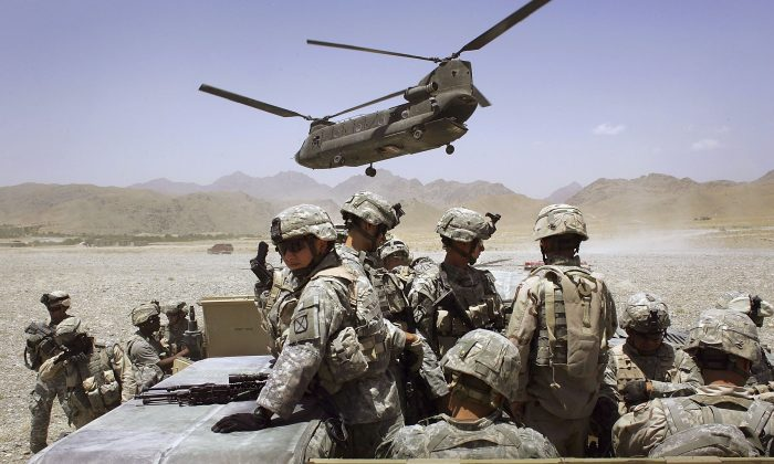 American soldiers from the 10th Mountain Division deploy to fight Taliban fighters as part of Operation Mountain Thrust to a U.S. base near the village of Deh Afghan in the Zabul province of Afghanistan  on June 22, 2006. (John Moore/Getty Images)