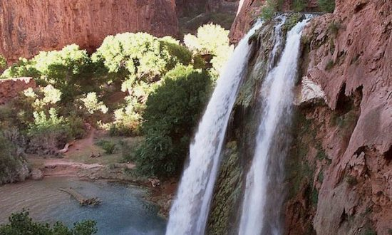 This 1997 file photo shows one of five waterfalls on Havasu Creek as its waters tumble 210 feet on the Havasupai Tribe's reservation in a southeastern branch of the Grand Canyon near Supai, Ariz. (AP Photo/Bob Daugherty)
