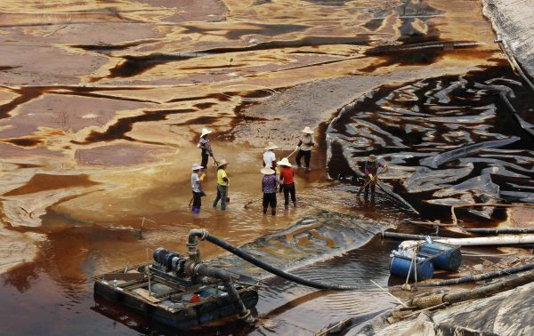 Workers drain away polluted water
