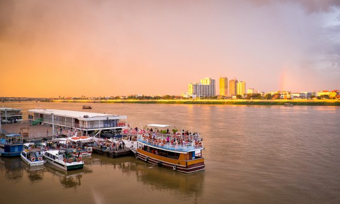 Tourist boats at a pier on the Mekong River in Phnom Penh, capital of Cambodia. (Shutterstock.com)