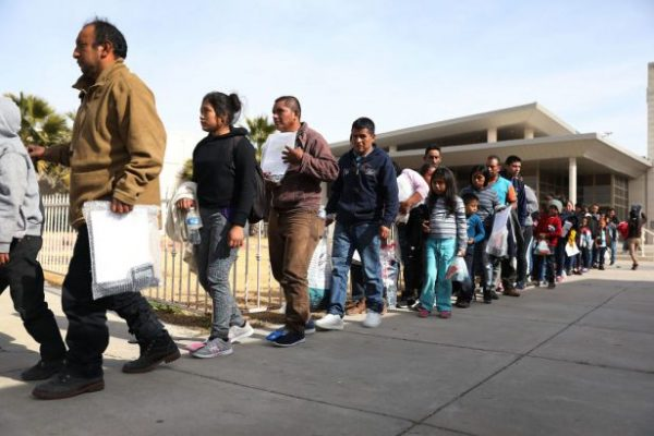 Migrants arrive at an Annunciation House facility