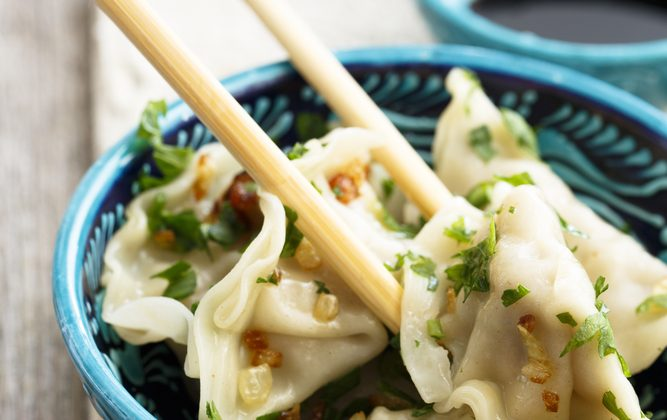For many Chinese families, making dumplings is synonymous with Chinese New Year's Eve. (Shutterstock)