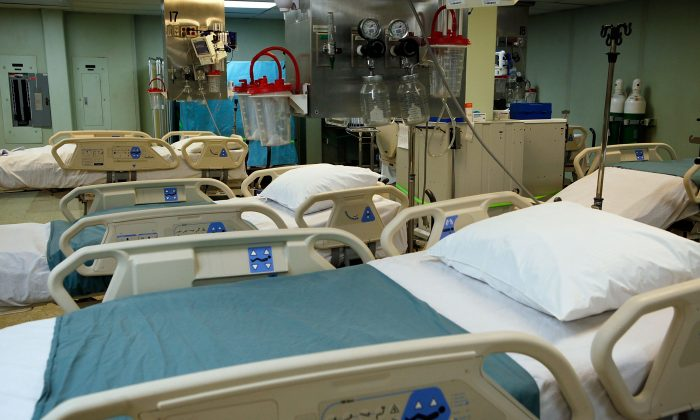 In this file images, beds are prepared in the intensive care unit section of a hospital ship on Jan. 15, 2010 in Baltimore, Maryland. (Alex Wong/Getty Images)