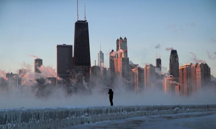 A man walks along an ice-covered break-wall along Lake Michigan while temperatures hovered around -20 degrees and wind chills neared -50 degrees on Jan. 31, 2019, in Chicago, Illinois. (Scott Olson/Getty Images)