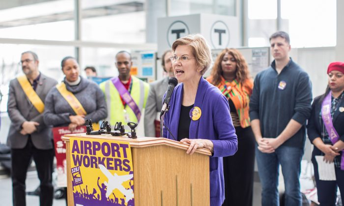 Sen. Elizabeth Warren (D-Mass.) speaks during a rally for airport workers affected by the government shutdown at Boston Logan International Airport in Boston, Massachusetts on Jan. 21, 2019. (Scott Eisen/Getty Images)