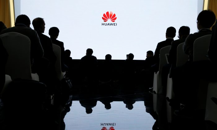People attend a product presentation at Huawei in Beijing on Jan. 24, 2019.   (Reuters/Thomas Peter)
