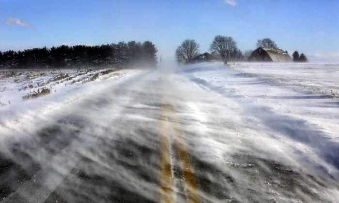 Drifting snow obscures a road near Mount Joy in Lancaster County, Pa., on Jan. 30, 2019. A bitter deep freeze is moving into the Northeast from the Midwest, sending temperatures plummeting and making road conditions dangerous. (Jacqueline Larma/AP Photo)