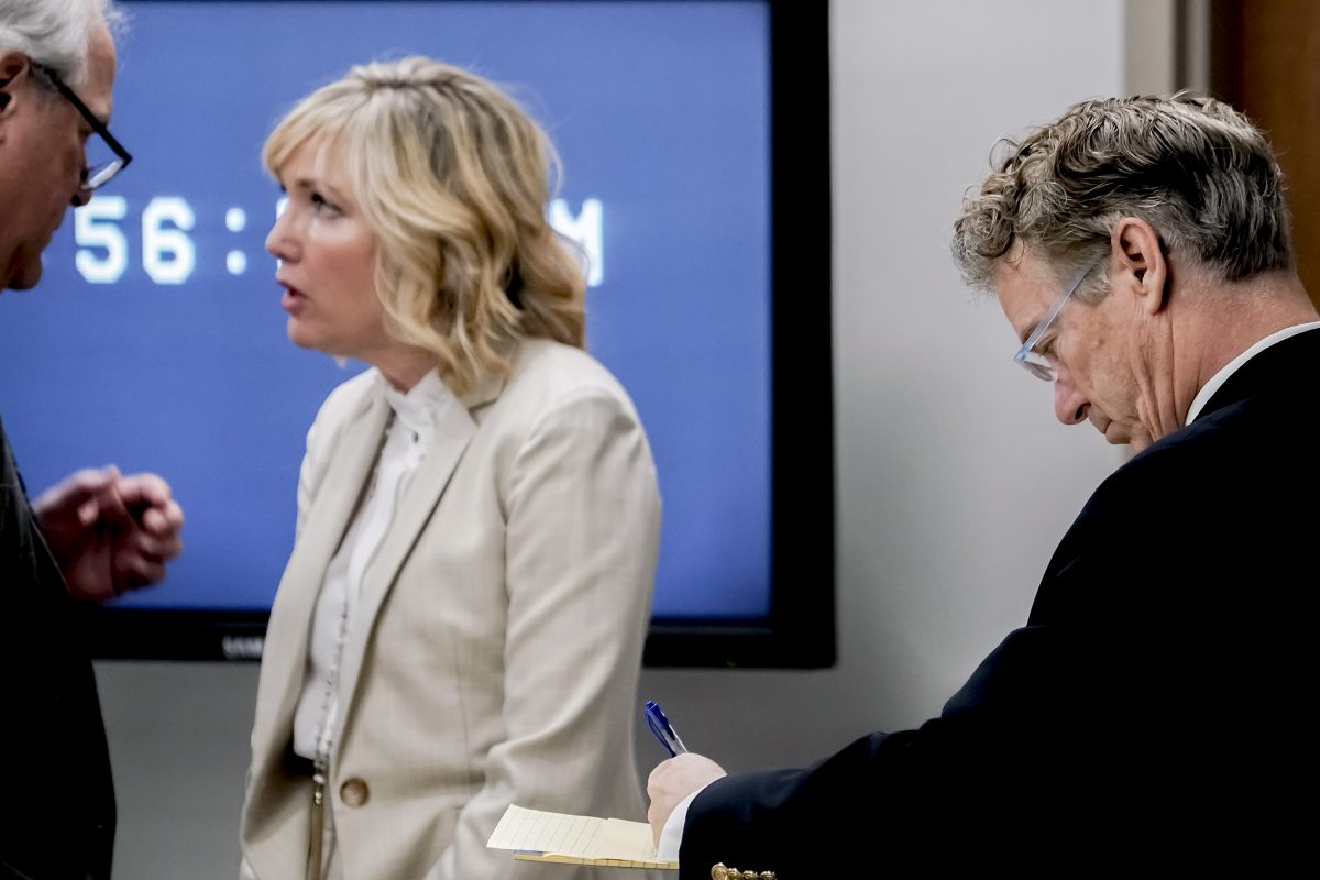 rand paul takes notes in court