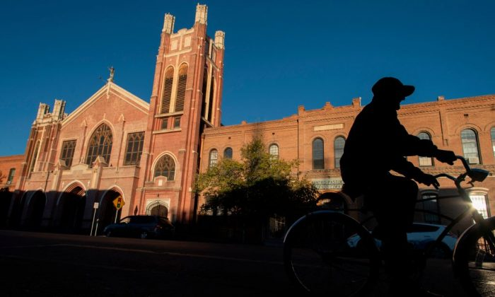 A man rides his bicycle past the Sagrado Corazon Church in the El Segundo Barrio in El Paso, Texas, on Nov. 28, 2018. (PAUL RATJE/AFP/Getty Images)