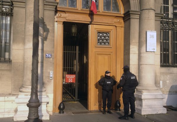 Police officers stand guard in front of the 36 Quai des Orfevres police headquarters