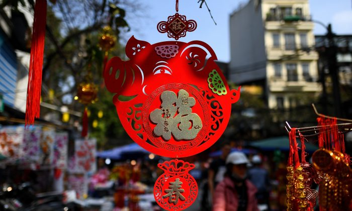 "A ""pig"" shaped decoration hangs outside a shop at a market in the old quarters of Hanoi on Jan. 28, 2019 ahead of the Lunar New Year. (Manan Vatsyayana/AFP/Getty Images)"